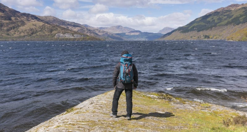 Walker taking in the view of Loch Lomond from Rowardennan