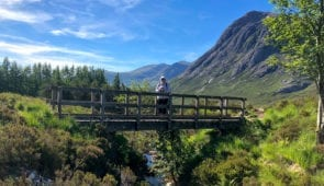 Hiker in spectacular scenery near Tyndrum