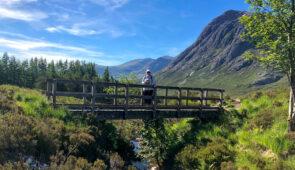 Hiker in spectacular scenery near Tyndrum