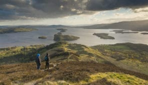 Walkers taking in the view of Loch Lomond from Conic Hill