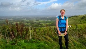 Charlotte from Absolute Escapes walking the South Downs Way