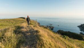 Hiker on the Southern Upland Way at Killantringan, near Portpatrick