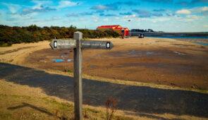 Norfolk Coast Path waymarker with National Trails acorn symbol