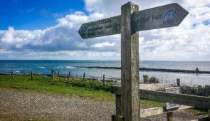 Northumberland Coast Path waymarker near Dunstanburgh Castle