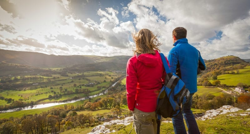 Walkers on Offa's Dyke Path overlooking Vale of Llangollen