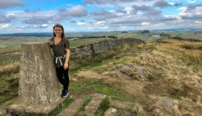 Caitlin from Absolute Escapes on the Hadrina's Wall Path at Caw Gap