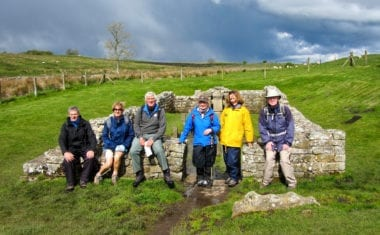 Walkers at the Temple of Mithras on Hadrian's Wall