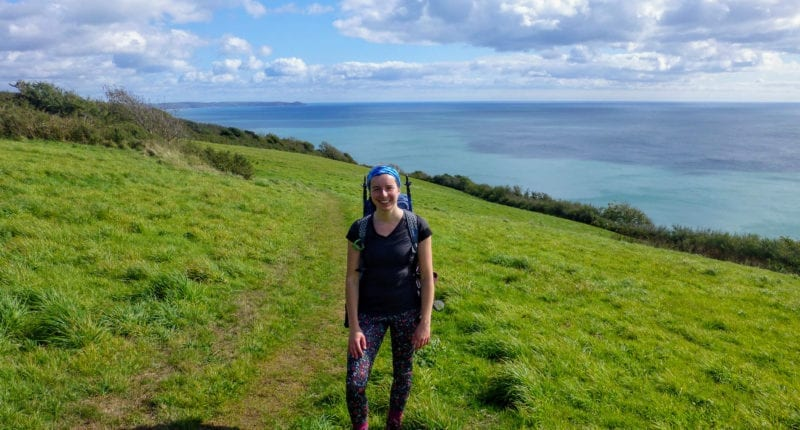 Megan from Absolute Escapes walking towards Rame Head