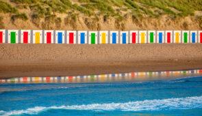 Colourful beach huts at Woolacombe beach