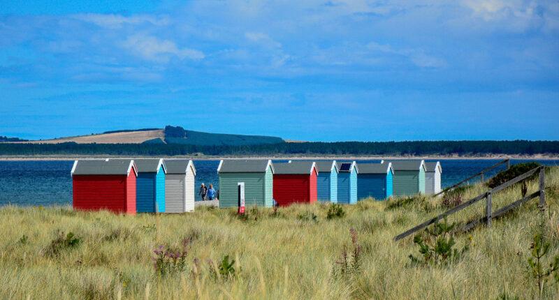 Colourful beach huts at Findhorn Beach