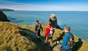 Three walkers on Pembrokeshire Wales Coast Path