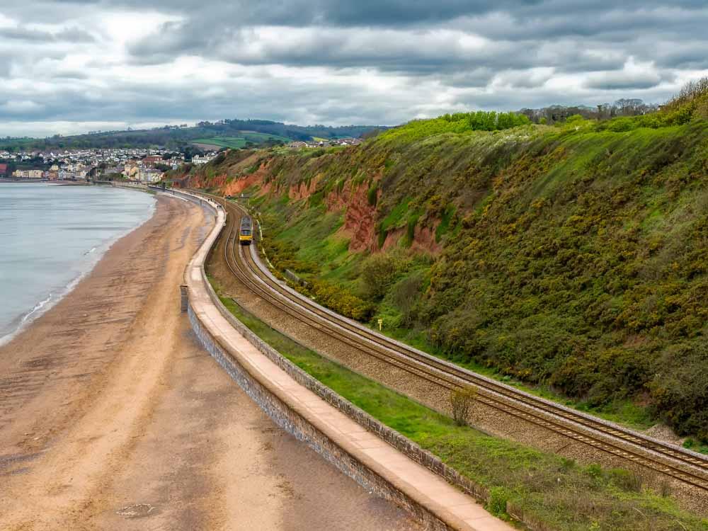 Walking-along-the-sea-wall-at-Dawlish