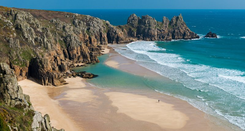 Pedn Vounder Beach, backed by the Logan Rock, Cornwall