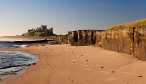 Sandy beach looking towards Bamburgh Castle
