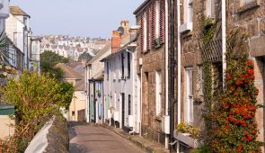 Narrow Cornish lane lined with pretty cottages in the town of St Ives
